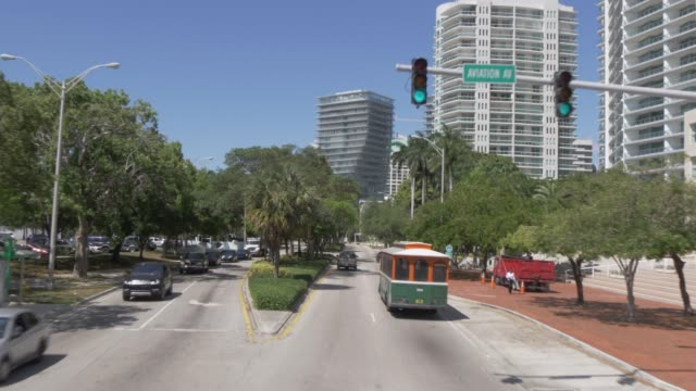 travelling through coconut grove toward coral gables, miami, florida, united states of america, north america - grove stock videos & royalty-free footage