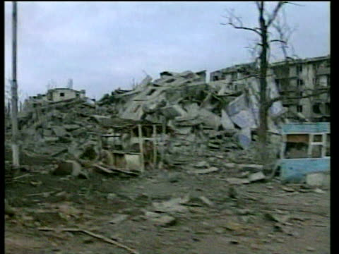 travelling through war torn streets of grozny 18 feb 00 - grosny stock-videos und b-roll-filmmaterial