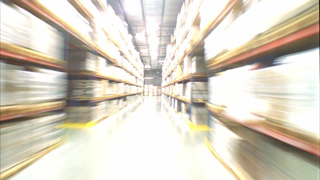 ms pov t/l travelling through warehouse environment / lebec, california, united states - storage compartment stock videos and b-roll footage