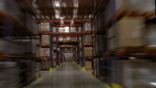 stockvideo's en b-roll-footage met ws pov t/l travelling through warehouse / lebec, california, united states - heftruck
