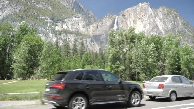 travelling through yosemite valley and upper yosemite falls, yosemite national park, unesco world heritage site, california, united states of america, north america - yosemite national park stock-videos und b-roll-filmmaterial