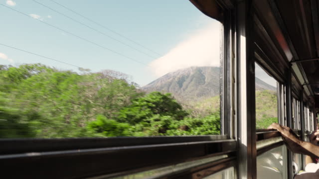 travelling with bus at tropical country - 中央アメリカ点の映像素材/bロール