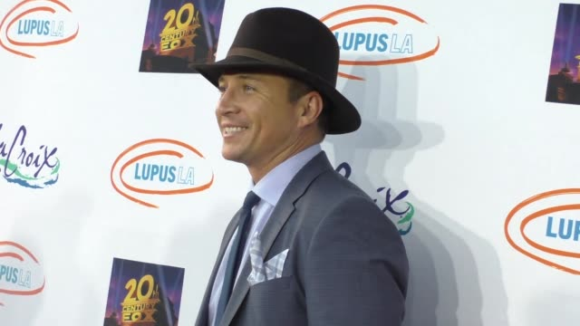 travis aaron wade at the lupus la orange ball a night of superheroes at fox studios in los angeles at celebrity sightings in los angeles on may 07... - lupus la orange ball video stock e b–roll