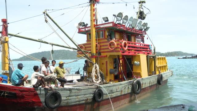 MS PAN Trawler boat moving out of fishing port / Kota Kinabalu, Sabah, Malaysia