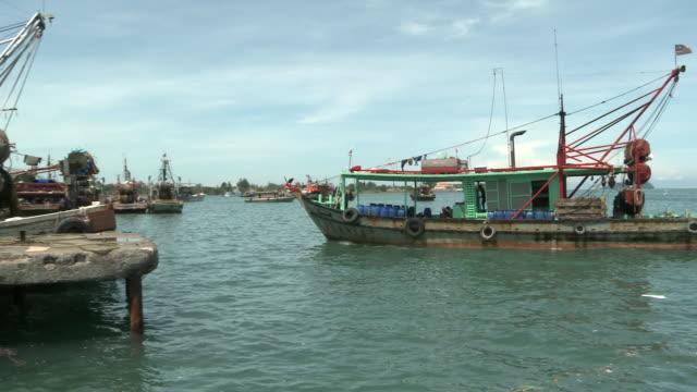 PAN Trawler boats coming into fishing port / Kota Kinabalu, Sabah, Malaysia