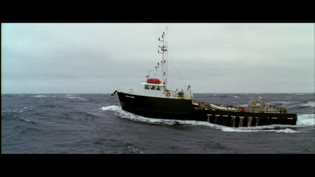 TS Trawler breasting a heavy, rolling sea