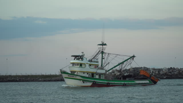 trawler, fishing boat entering the itajaí canal - fishing boat stock videos & royalty-free footage