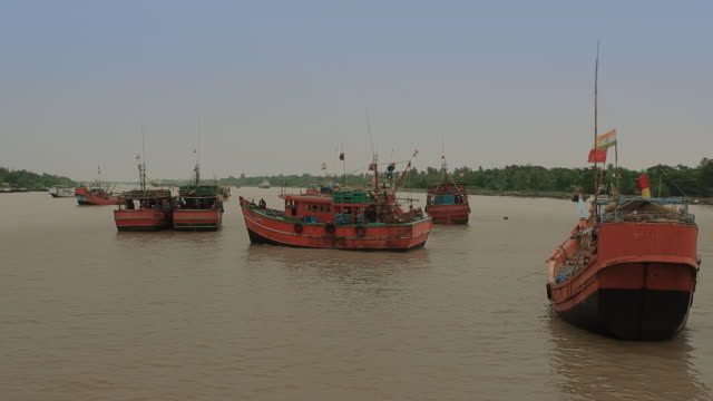 a trawler prepares to set sail from the hatania doania creek in namkhana west bengal india - west bengal stock videos and b-roll footage