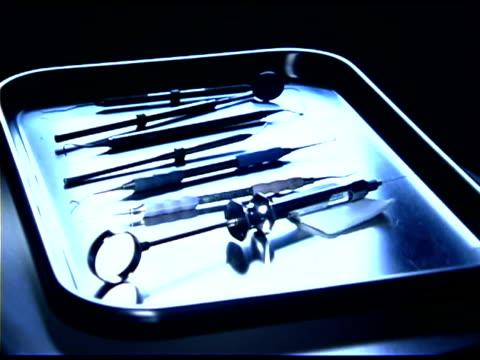tray of dental instruments - getönt stock-videos und b-roll-filmmaterial