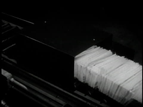 1957 cu tray of mail traveling on conveyor line / united states - 1957 stock videos & royalty-free footage