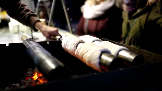 trdelnik pastries, typical national dessert in prague - prague stock videos & royalty-free footage