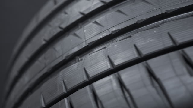 tread pattern on a car street tire - brake stock videos & royalty-free footage