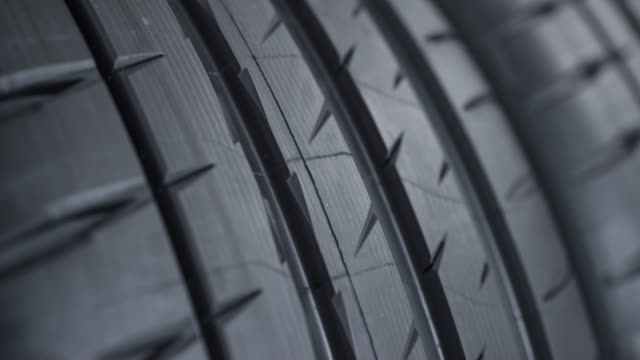 tread pattern on a car street tire - tire track stock videos & royalty-free footage