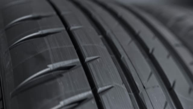 tread pattern on a car street tire - materiale video stock e b–roll