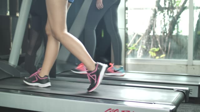treadmill workout, walking close-up legs - racewalking stock videos and b-roll footage