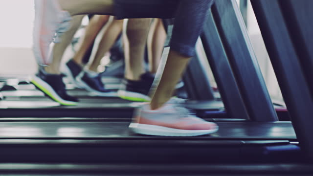 treadmills allows us to run come rain or shine - treadmill stock videos & royalty-free footage