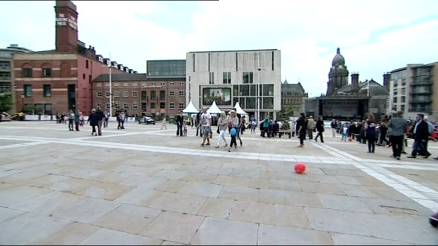 treasure hunt craze reaches uk; england: west yorkshire: leeds: people along in square people chatting and along - treasure hunt stock videos & royalty-free footage