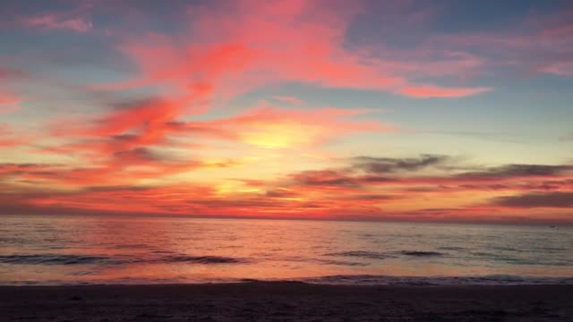treasure island florida sunset seen on 12/23/17 - gulf of mexico stock videos & royalty-free footage