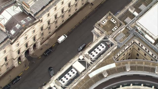 treasury and houses of parliament aerial views george osborne mp out of treasury building and into car / george osborne's car leaves treasury... - ロンドン ホワイトホール点の映像素材/bロール