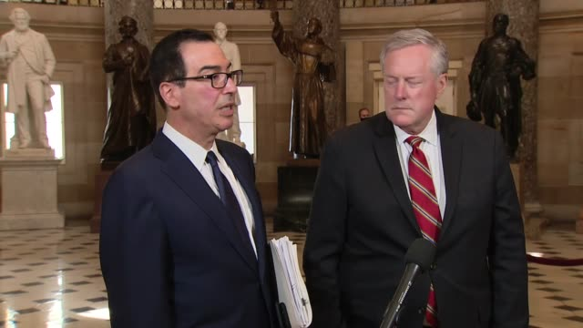 treasury secretary steve mnuchin tells a reporter in statuary hall alongside white house chief of staff mark meadows about negotiations on the heals... - financial item stock videos & royalty-free footage