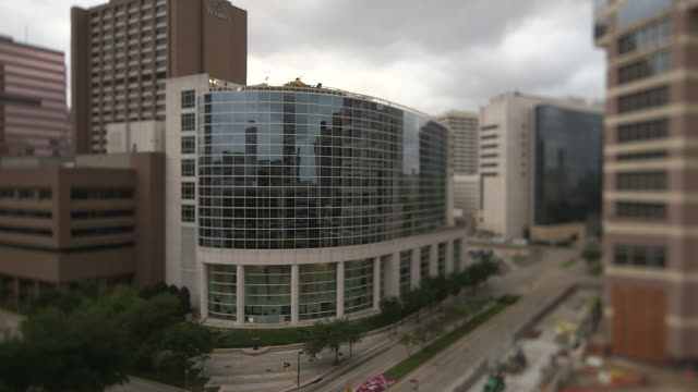 treated long shot of the exterior of st luke's episcopal hospital, houston. - medical building stock videos and b-roll footage