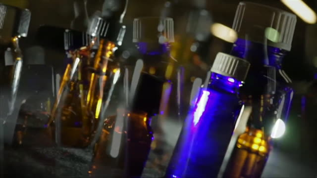 treated shots of blurred drug bottles used in story about ghb - blurred motion stock videos & royalty-free footage