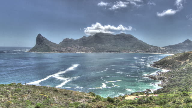 treated time lapse shot of clouds drifting over the city of cape town and table bay. - lion's head mountain stock videos and b-roll footage