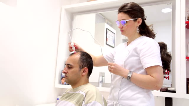 Treatment and stimulation of hair growth.