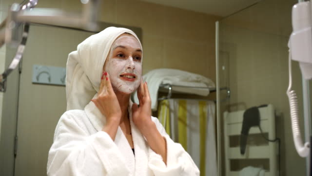 treatment with facial mask - anti aging stock videos & royalty-free footage