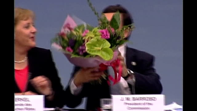 EU Treaty agreed / Blair meets Pope BELGIUM Brussels EU Commission President Juan Manuel Barroso presenting bouquet of flowers to German Chancellor...