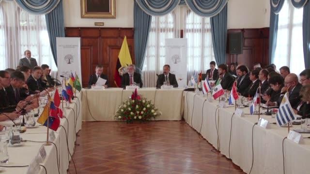 trece paises de latinoamerica sin la participacion del gobierno de nicolas maduro comenzaron el lunes a discutir formulas para regularizar a los... - discutir stock videos & royalty-free footage