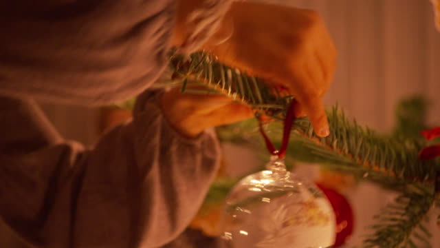 tree decorating with painted glass balls - fir tree stock videos and b-roll footage