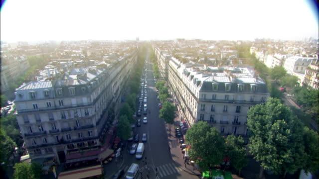 tree-lined boulevards run between blocks of multistory buildings in modern day paris. - boulevard stock videos & royalty-free footage