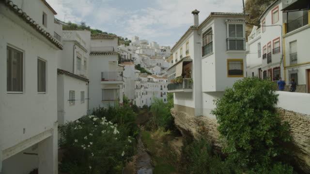 trees and urban buildings on hillside / setenil de las bodegas, malaga, spain - cádiz stock videos and b-roll footage