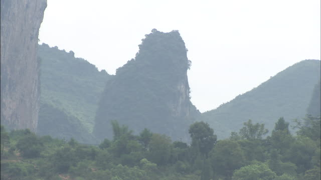 trees at base of karst formation. - karst formation stock videos & royalty-free footage