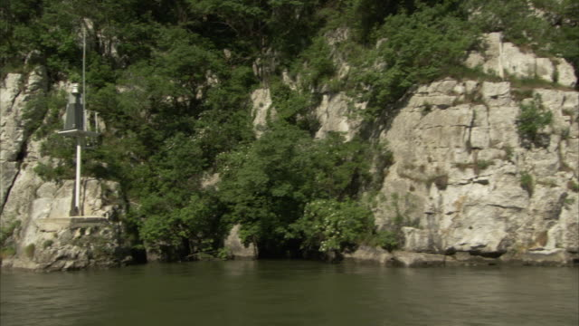 Trees cover cliffs along the edges of the Danube River.