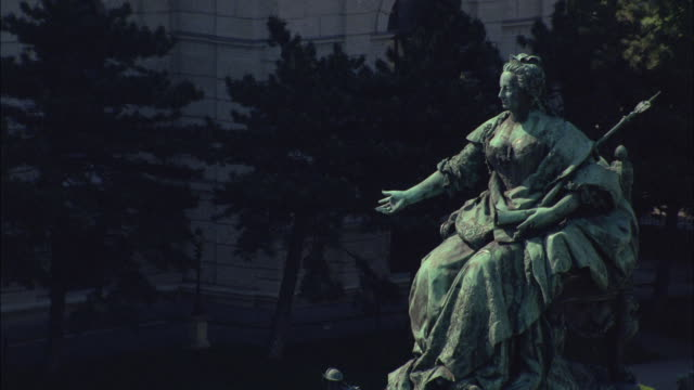 Trees create a background for a statue of Empress Maria Theresa in Vienna, Austria.