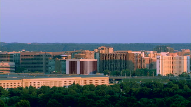 trees grow around the pentagon and other government buildings in pentagon city, washington, dc. - arlington virginia video stock e b–roll