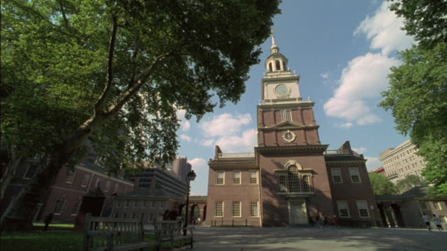 trees grow near independence hall in philadelphia. - independence hall stock videos & royalty-free footage