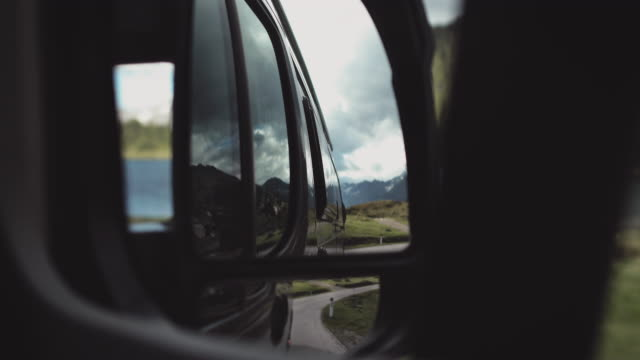 trees on mountain seen through side-view mirror - wing mirror stock videos & royalty-free footage