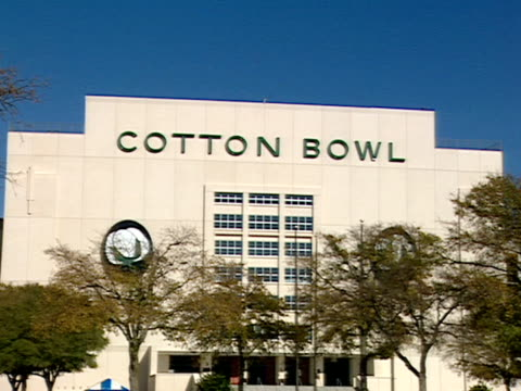 Trees shade the plaza in front of the Cotton Bowl stadium at Fair Park Dallas Texas