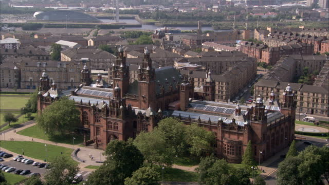 Trees surround the Kelvingrove Museum in Glasgow Scotland. Available in HD.
