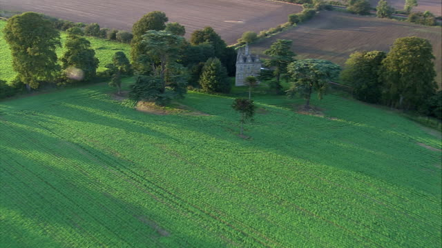 Trees surround the Rushton Triangular Lodge in Northamptonshire England. Available in HD.