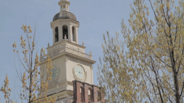 la treetops swaying below independence hall's bell tower / philadelphia, pennsylvania, united states - independence hall stock videos and b-roll footage