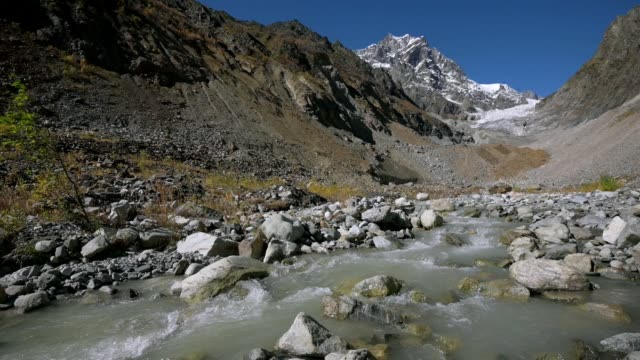 trekking around caucasus mountains on the border of russia and georgia. chalaat pass and very beautiful view of the chalaadi glacier - ジョージア調点の映像素材/bロール