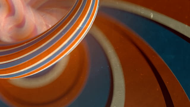 trendy background with moving colored stripes. rotation colored lines optical illusion with a depth of field on old scratched surface. seamless loop animation. 3d rendering. hd - chiocciola gasteropode video stock e b–roll