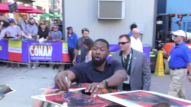 Trevante Rhodes signs autographs for fans on Day 1 of 2018 ComicCon in San Diego in Celebrity Sightings at ComicCon San Diego