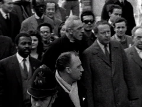 trevor huddleston and hugh gaitskell lead antiapartheid demonstrators through london seeking a boycott on products from south africa - apartheid stock videos & royalty-free footage