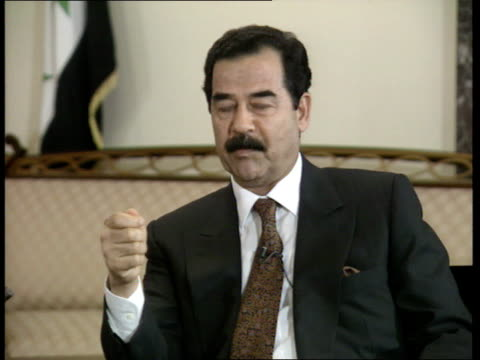 trevor mcdonald talks to saddam hussein; iraq: baghdad saddam hussein interview sof -dialogue must be conducted with us. -israel's criminal acts... - saddam hussein stock videos & royalty-free footage