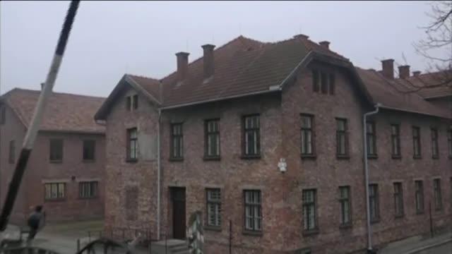 Trial of former Auschwitz guard Oskar Groening begins T26011549 / TX Auschwitz ITN Drone Camera footage 'Arbeit Macht Frei' entrance gates with camp...